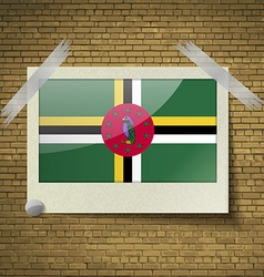 Flags dominica at frame on a brick background vector