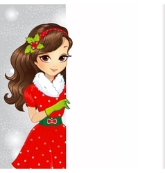 Beautiful brunette santa girl holding banner vector