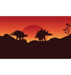 Silhouette of two stegosaurus on the cliff vector