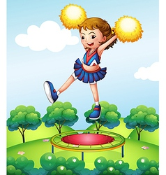 A trampoline below a young cheerdancer vector image
