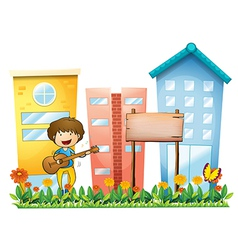 A boy with a guitar beside an empty wooden vector image