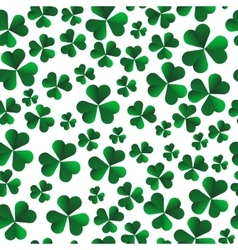 Seamless pattern with green shamrock leaves vector