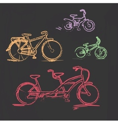Sketched chalky bicycle set on blackboard vector image