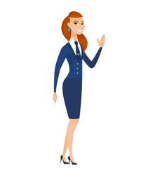 Young caucasian stewardess waving her hand vector