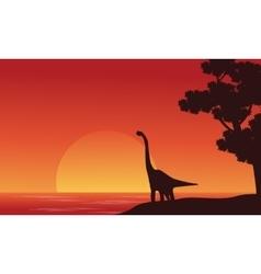 Silhouette of dinosaur brachiosaurus on riverbank vector