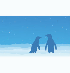 Silhouette of penguin on snow at night vector