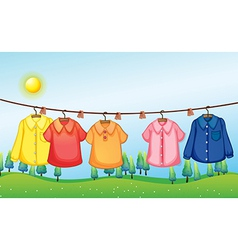 Washed clothes hanging under the sun vector