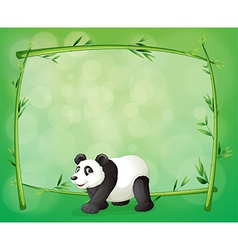 A framed bamboo with a big panda vector