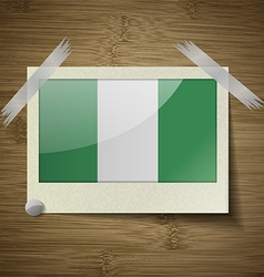 Flags nigeria at frame on wooden texture vector