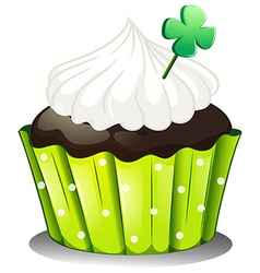A chocolate cupcake with a green plant vector