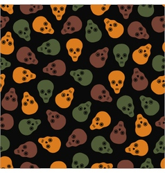 Seamless pattern of skulls on a dark background vector