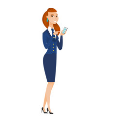 Caucasian stewardess holding a mobile phone vector