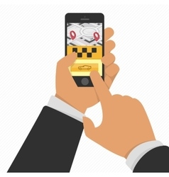 Hand holding phone with taxi service app vector image