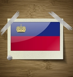 Flags liechtenstein at frame on wooden texture vector