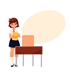 Smiling school girl standing at the desk holding a vector