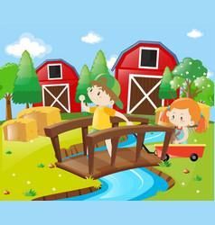 Boy and girl in the farmyard vector