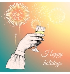 Hand holding a glass of tipple vector image