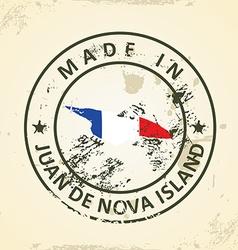 Stamp with map flag of juan de nova island vector