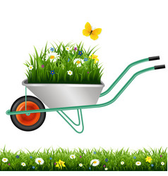 Garden wheelbarrow and grass with flowers vector