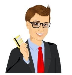 Businessman holding golden credit card vector