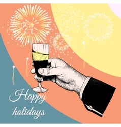 Hand holding a glass of tipple vector