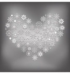 Heart made of white snowflakes vector