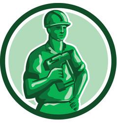 Green construction worker nailgun circle retro vector