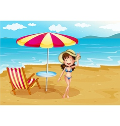A woman wearing a stripe swimsuit at the beach vector