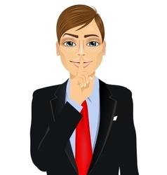 Businessman making silence or secret hand gesture vector
