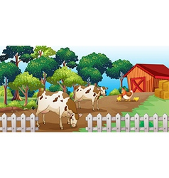 A farm with animals inside the fence vector image