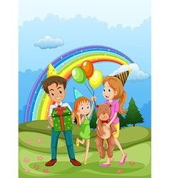 A happy family at the hilltop and a rainbow in the vector