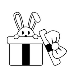 Bunny or rabbit coming out of gift box easte vector