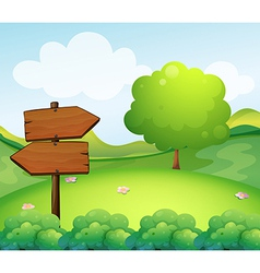 A wooden arrow board in the hill vector