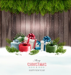 Christmas background with gift boxes and tree vector image