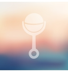 Rattle icon on blurred background vector