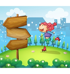 A girl skating in the garden with a wooden arrow vector image vector image