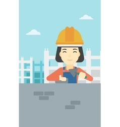 Bricklayer with spatula and brick vector