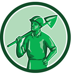 Green miner holding shovel circle retro vector