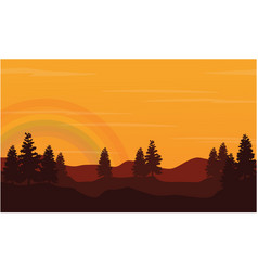 Silhouette of hill with rainbow at sunset vector