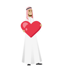 Muslim businessman holding a big red heart vector