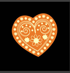 Patterned yellow heart on a black background vector