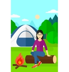 Woman sitting at camp vector