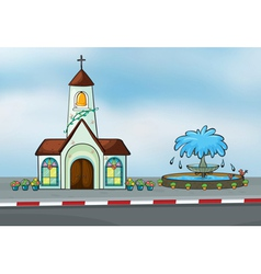 A church and a fountain vector image
