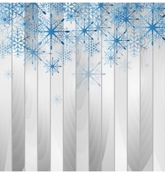 Blue falling snowflakes on wooden background vector