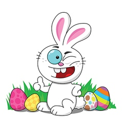 Easter bunny with eggs winking vector