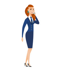 Stewardess talking on a mobile phone vector