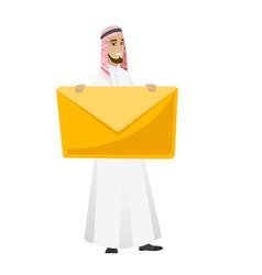 Smiling businessman holding a big envelope vector