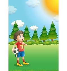 A young football player at the hill vector