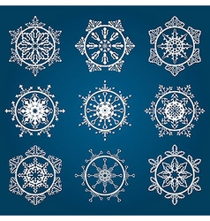 9 detailed white snowflakes vector
