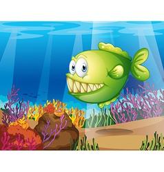 A green piranha vector image